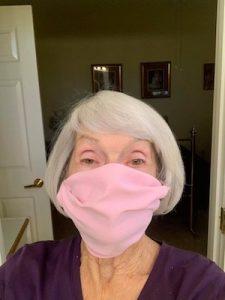 Sandi wearing a pink mask
